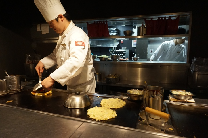 Japanese chef making okonomiyaki